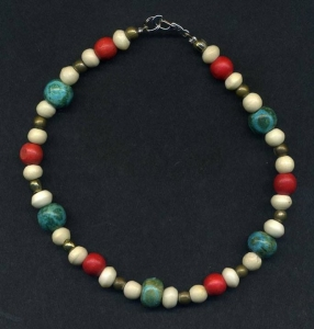 Turquoise, coral, and ivory colored ankle bracelet.