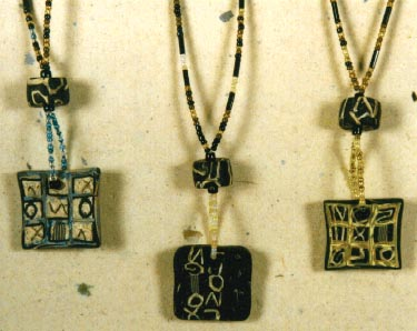Three necklaces with polymer clay pendants.