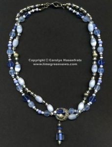 Blue and silver necklace with charm that slides off.
