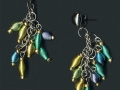 Earrings made from metal beads and seed beads and chain recycled from thrift store jewelry.
