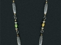 Necklace made from wire, metal beads and seed beads. Metal chain and some of the seed beads are recycled from thrift store jewelry.