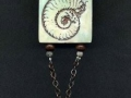 Necklace with mollusk pendant.