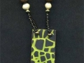 Necklace with lime green and black rectangular pendant.