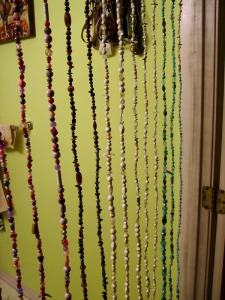 I've always wanted a beaded curtain, so I made one for my bathroom door from recycled florist wire and plastic beads mostly taken from thrift store jewelry. One wall in the bathroom is painted my favorite color, lime green. The other walls will be painted when the tile work on the walls is finished.