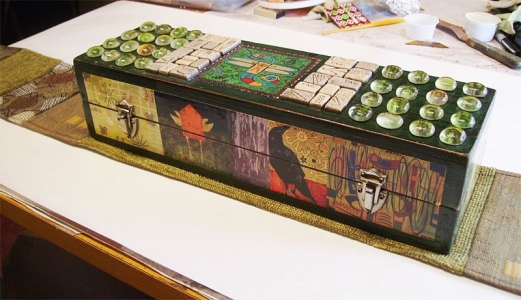 Ammo box decorated with mixed media including decoupage.