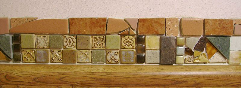 I'm in the process of improving my kitchen backsplash with tile work. Here is a closeup showing some tiles I made and others I salvaged mixed with a few that I purchased.