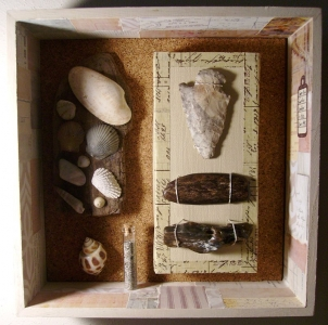 Here is a close-up of one of my shadow boxes that contains beachcombing finds. I found the spear point on a sandbar in the Mississippi River while on a float trip.