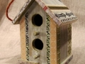 This decorative bird house was decoupaged with paper pieces, some rubber stamped with permanent ink.