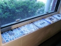 Here are the tiles installed in my windowsill and grouted.