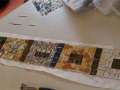 This picture shows tiles for a windowsill being laid out on paper. Some of these tiles I made, others were salvaged.