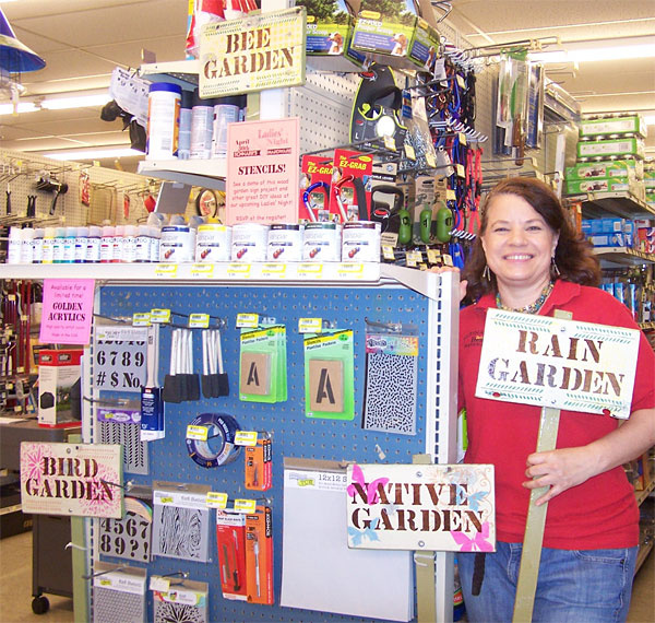 Me with wood garden signs that I made along with supplies I used to make them. I'll be demonstrating stenciling at Schnarr's Ladies' Night, April 30th, 2015.