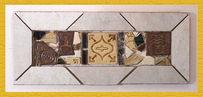 Frame of salvaged tiles filled with handmade tiles, salvaged tiles and purchased tiles.