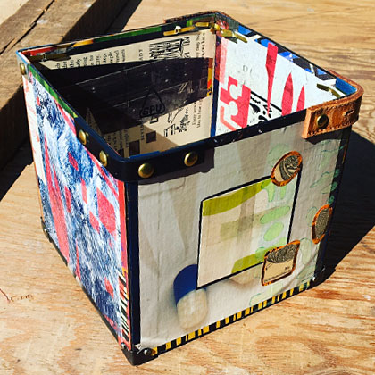 Storage box with pieces of old belts on the corners