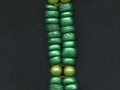 Double stranded bracelet made with polymer clay beads coated with Emerald PearlEx powder.