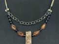 Necklace with rectangular sun pendant.