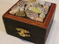 This box was decorated on top with faux beach glass pieces backed with decorative paper.